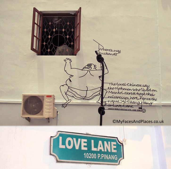 """""""Love Lane"""": A man clings onto the drain pipe outside the window of his mistress's room. His wife has just made a surprised visit looking for him: """"Where is my husband?"""" """"The local Chinese say the rich men who lived on Muntri Street kept their mistresses here, hence the name """"Ai Cheng Hang or Love Lane""""""""."""
