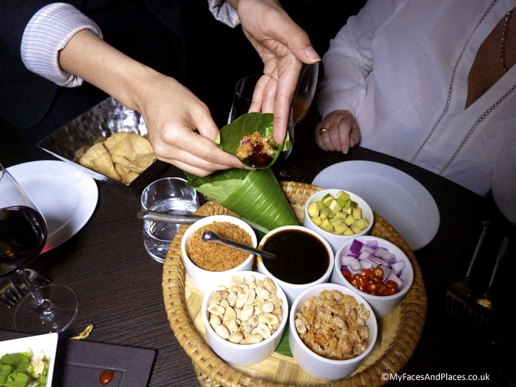 Meung Kum a traditional snack and royal dish of assorted ingredients served in a wrap of betel leaves with sweet tamarind sauce - Ladyboys and Mango Tree Restaurant