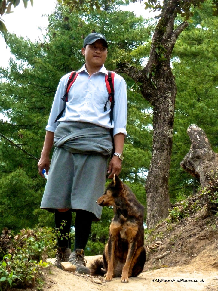 Our wonderful guide Jamyang Tenzin with a stray dog that greeted climbers to Tiger's Nest