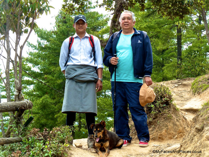Jamyang Tenzin and Michael with a stray dog who welcomed them back after the climb to Tiger's Nest