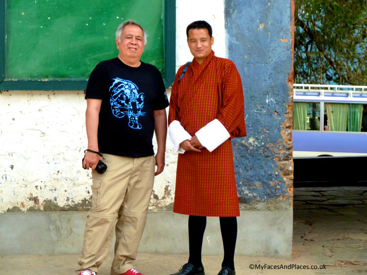 Our amazing guide Jamyang Tenzin dressed in gho, the traditional costume for men; and Michael Oon - Bhutan the Beautiful