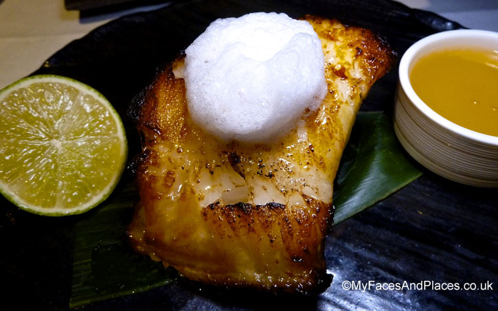 Pan fried Chilean sea bass with egg white foam and champagne and honey sauce in Chai Wu @ Harrods.