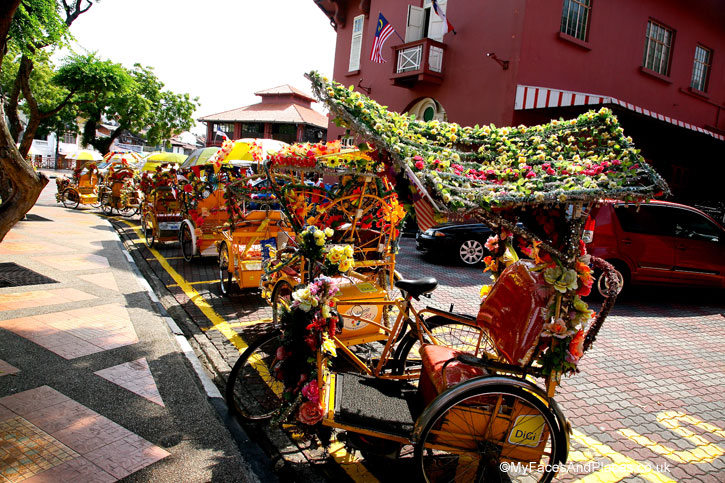Gaudy trishaws with a riot of plastic flowers are touristy mode of transport in Malacca