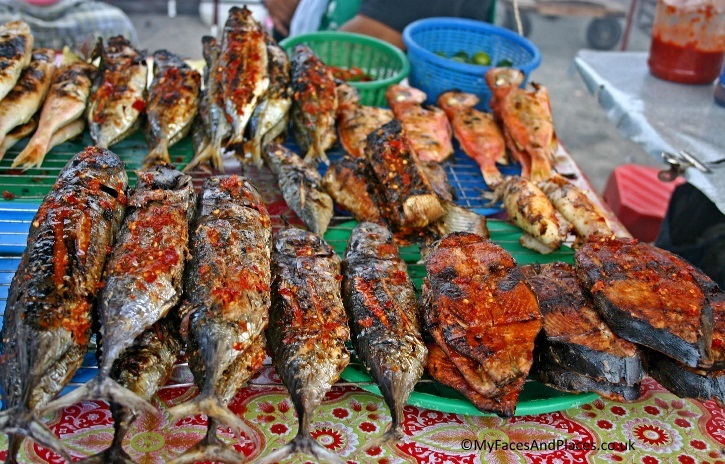 Scrumptious spicy fish fresh from the sea on offer in the market - in Sabah