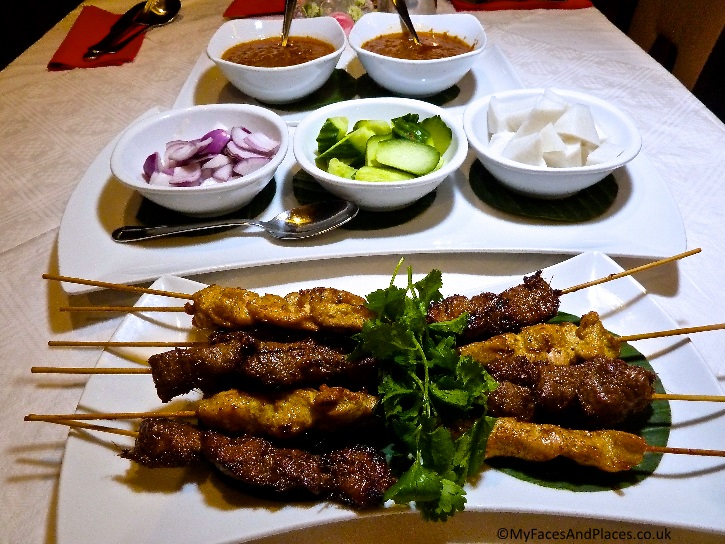 Lamb and chicken satay served with their condiments