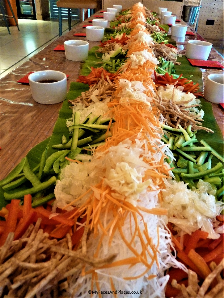 Lo Sang, the Prosperity Salad beautifully presented on a long table - Chinese New Year at Chi Kitchen
