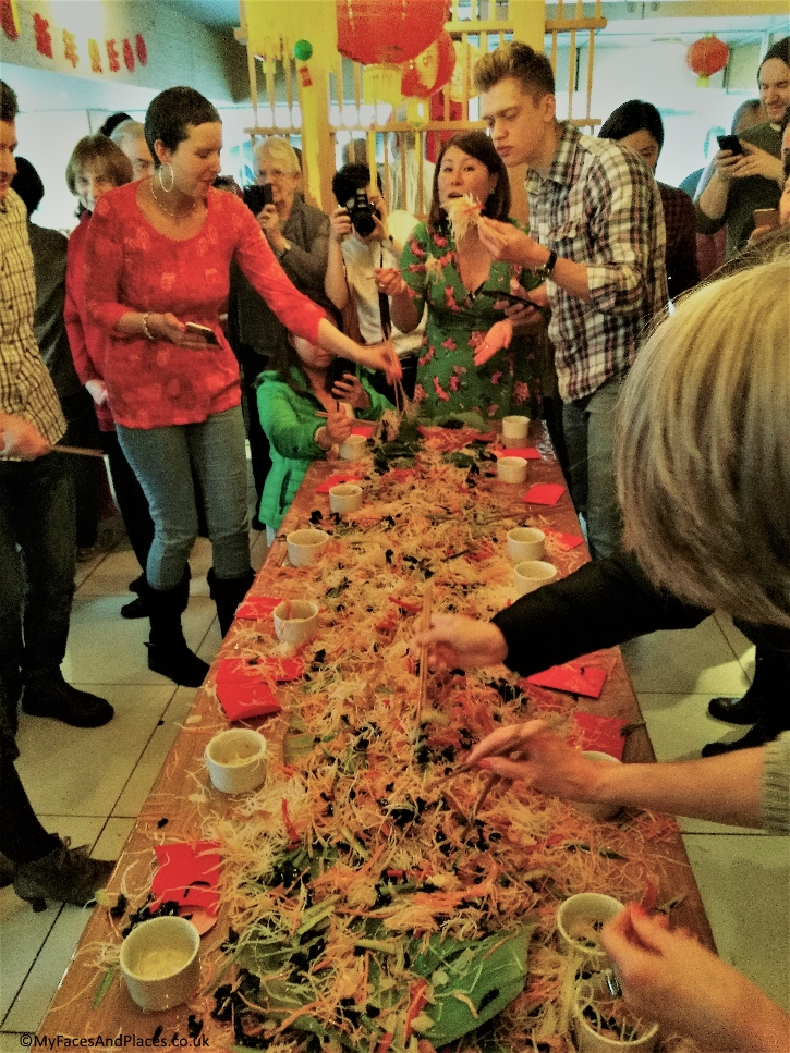 Ping Coombes leading the tossing of the Lo Sang Prosperity Salad