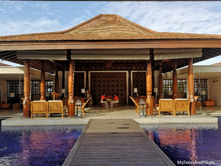 Bridge over tranquil water at the inviting entrance to Anantara Peace Haven