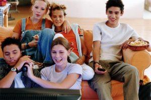 saturday morning movie teens watching a movie
