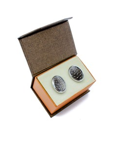 A pair of oval cufflinks, with guinea fowl feathers in presentation box.