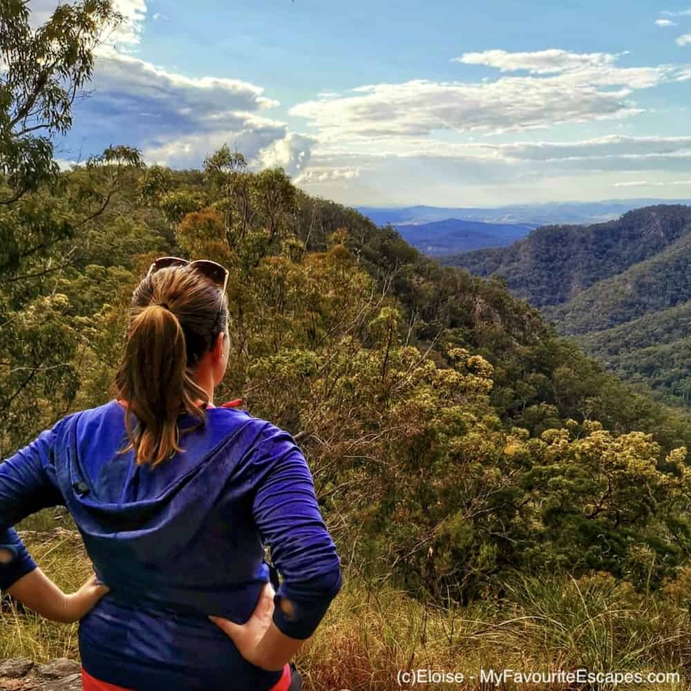 Woman looking at the view from Thilba Thalba lookout on Gheerulla Valley Circuit in Mapleton National Park