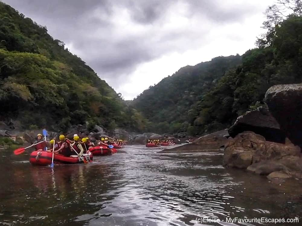Group of boats going down the Barron River - Cairns whitewater rafting