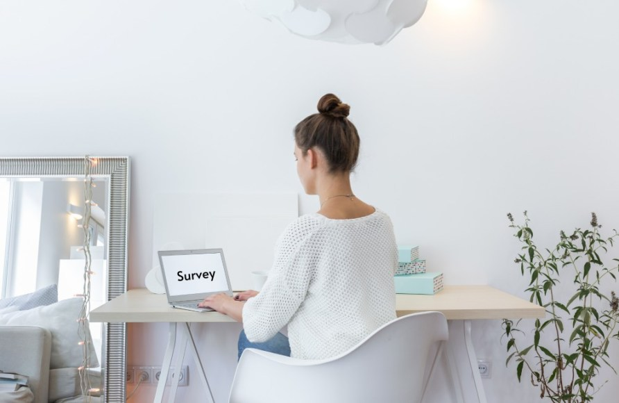 Woman Taking Survey- PayPal Stay at Home Survey - My Financial Hill