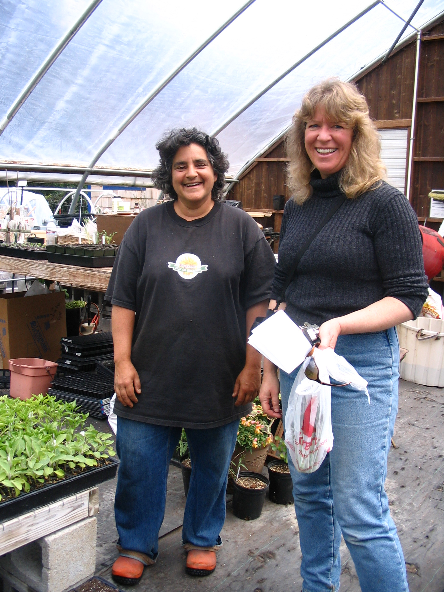 """Jennifer with the """"plant geek"""" Rita Jacinto at Flying Blue Dog farm --- after Jennifer whined about not having enough asparagus, Rita went into her field and picked some for her and Jessica...we arrived to get an interview and left with fresh asparagus -- these are two generous ladies!"""