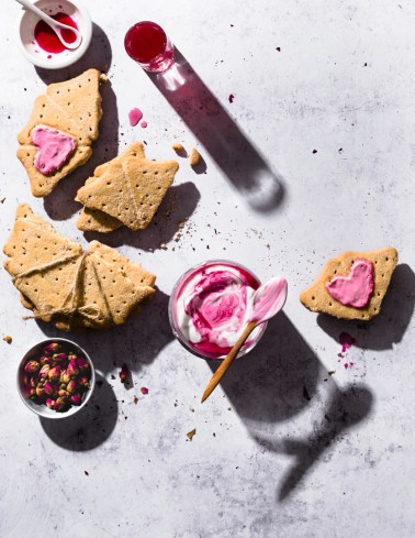 Overhead shot of buttery shortbread with rose flavoured coconut cream. Picture taken with hard light & strong shadows.