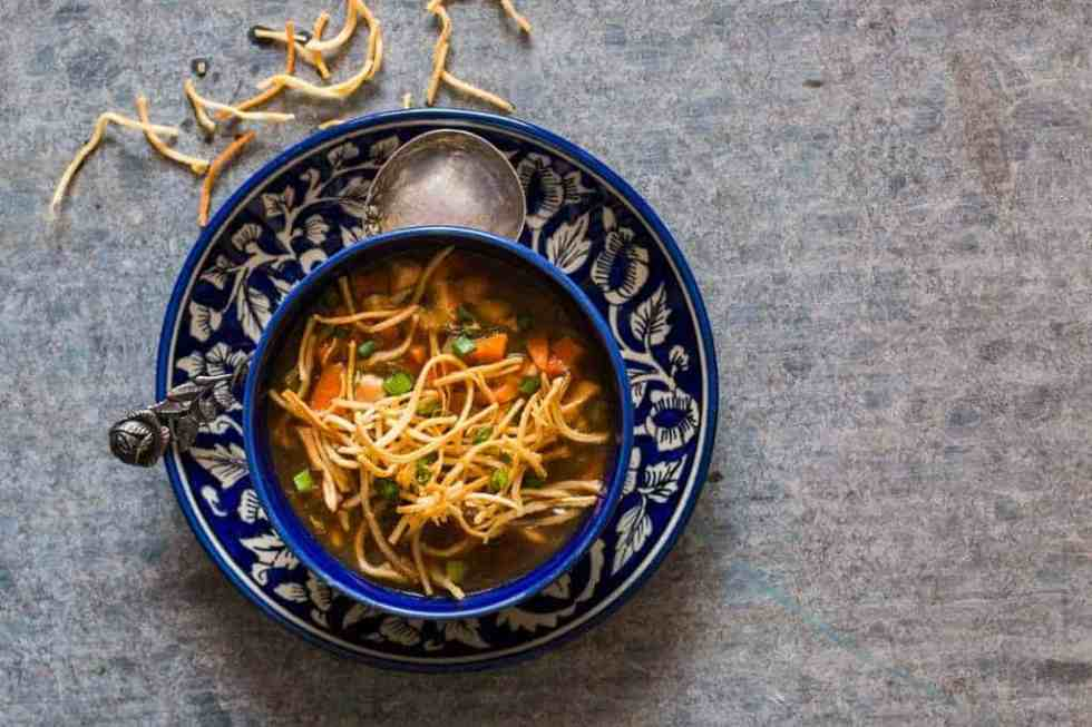 Chicken Manchow Soup is a spicy indo chinese soup, made popular by the street carts. This homemade version is an easy recipe and incredibly satisfying!