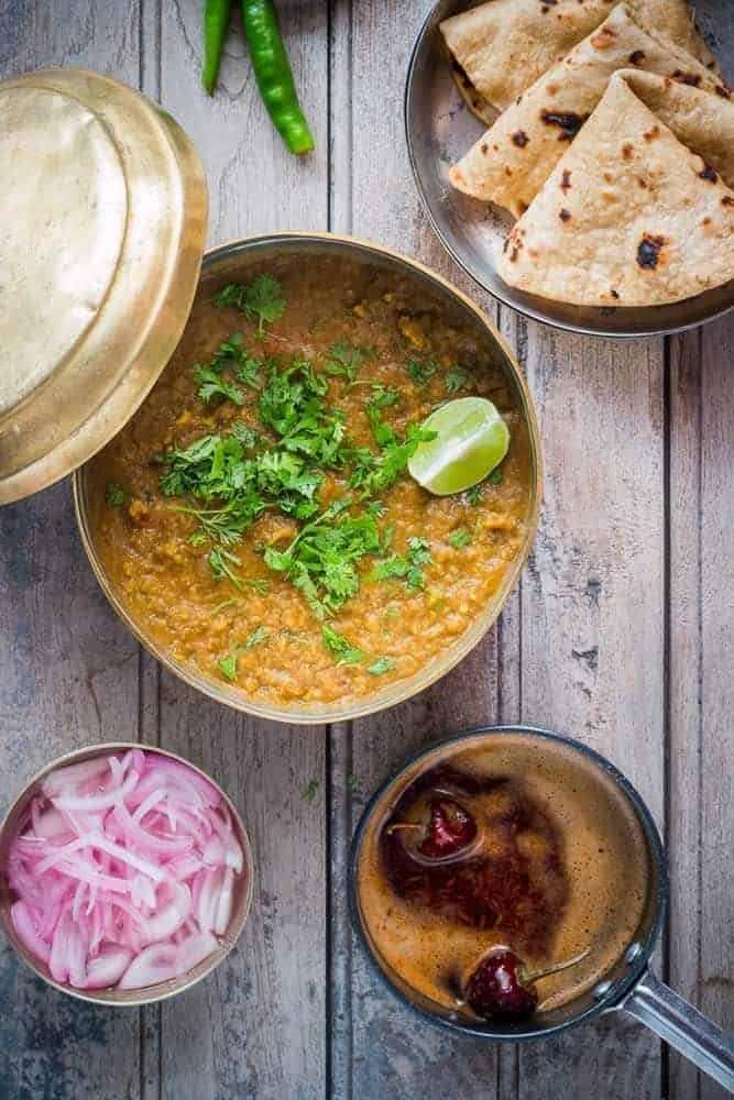 Dhabas are Indian roadside restaurants and this spicy, smoky lentil soup or dhal is inspired by them. This is a quick 30 minute dhaba style dal fry recipe which is wholesome and healthy. Food Photography and Styling by Richa Gupta. Vegetarian and Gluten Free.