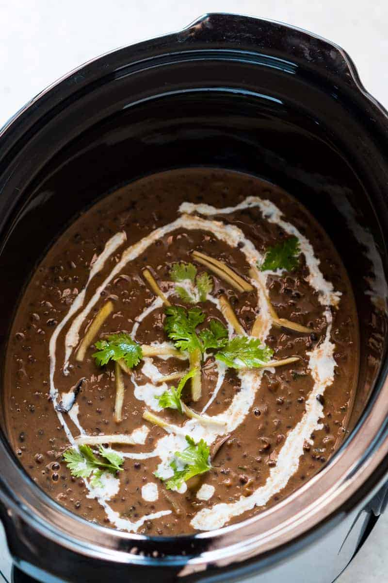 Easy, slow cooker dal makhani recipe, cooked overnight in a crockpot and tastes just like restaurants and dhabas. This black dal is perfect with rice and tandoori rotis!
