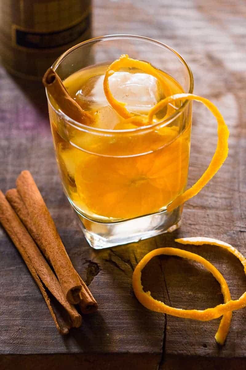 Simple tips to make orange cinnamon whiskey smash. A great fall cocktail that's perfect for the holiday table. Can be made with bourbon too.