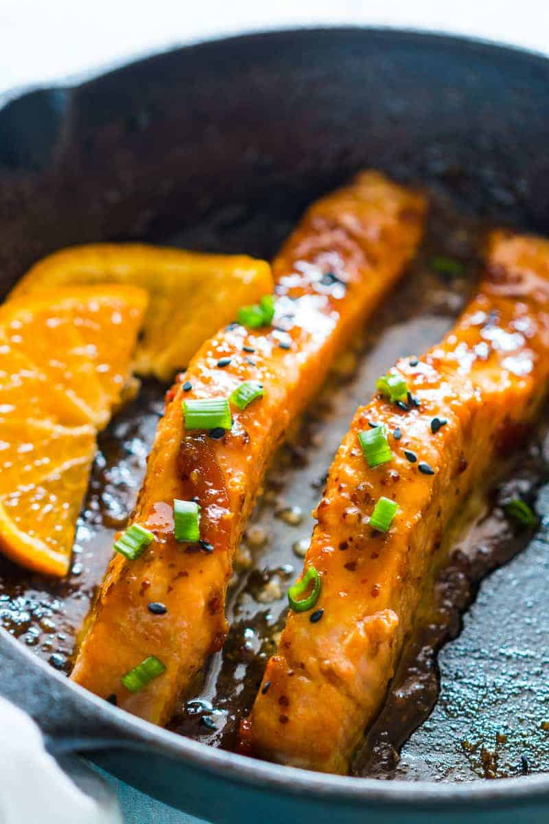 Pan seared orange mustard salmon - easy, healthy, 15 minute dinner with a sticky marinade. Clean eating ingredients, serve with pasta, cauliflower rice or asparagus.