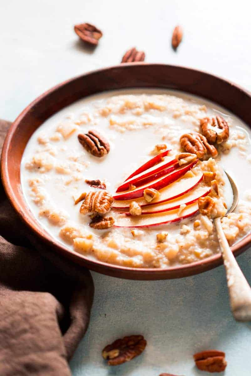 Quick and Healthy Apple Pie Oatmeal Breakfast Bowls - topped with pecan, honey and cinnamon. Stovetop recipe made with Quaker Oats.