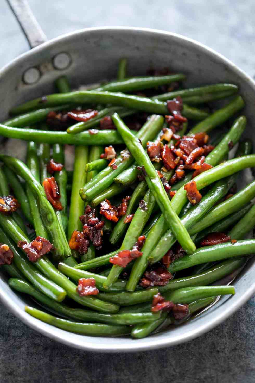 Sauteed Brown Sugar Bacon Garlic Green Beans is an insanely delicious side dish - sweet, garlicky with bits of candied bacon. Everyone will ask for seconds!