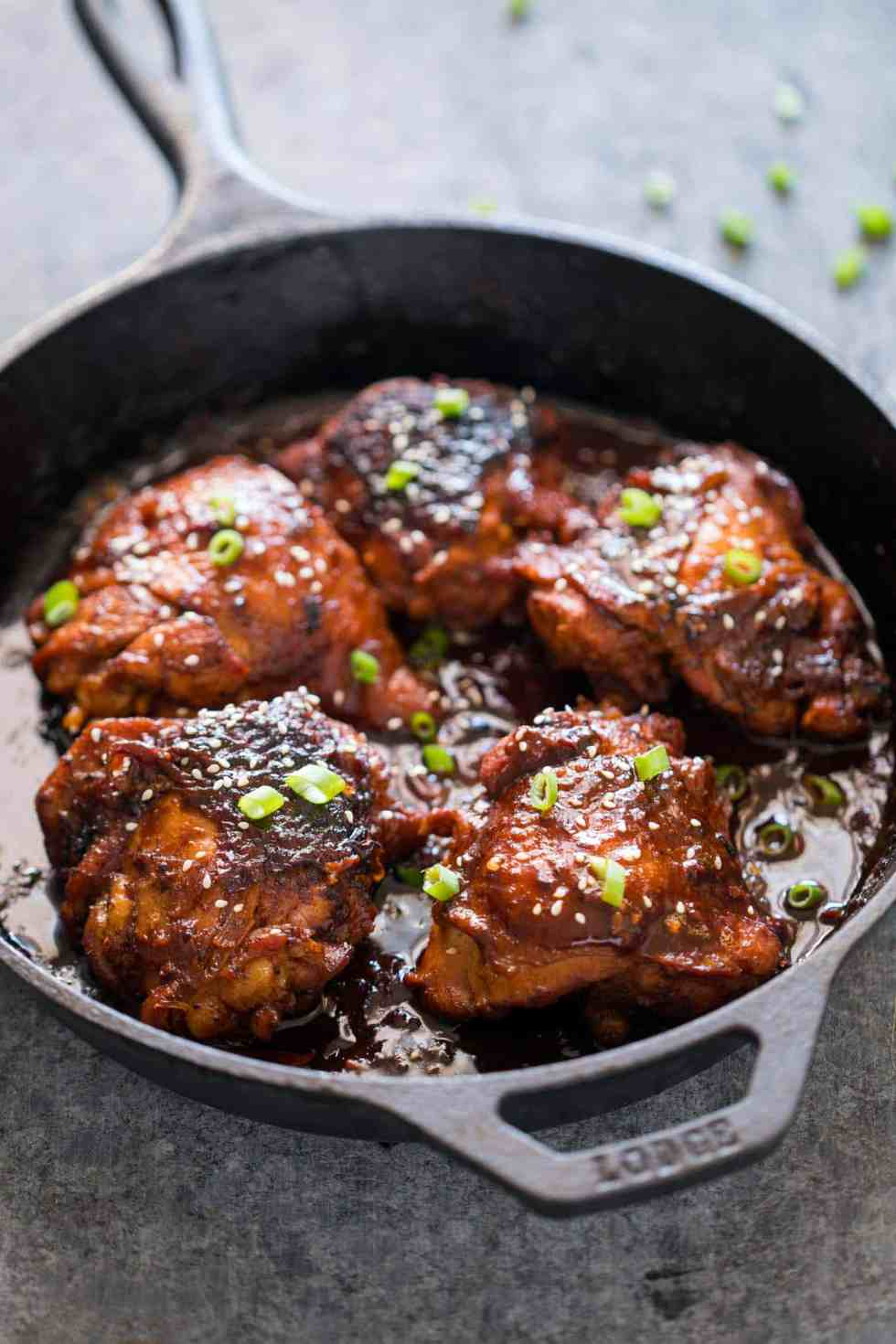 Spicy Korean Chicken Thighs in Gochujang Sauce - an intensely flavoured chicken recipe made in a cast iron pan for extra crispy, juicy thighs and a finger licking marinade!
