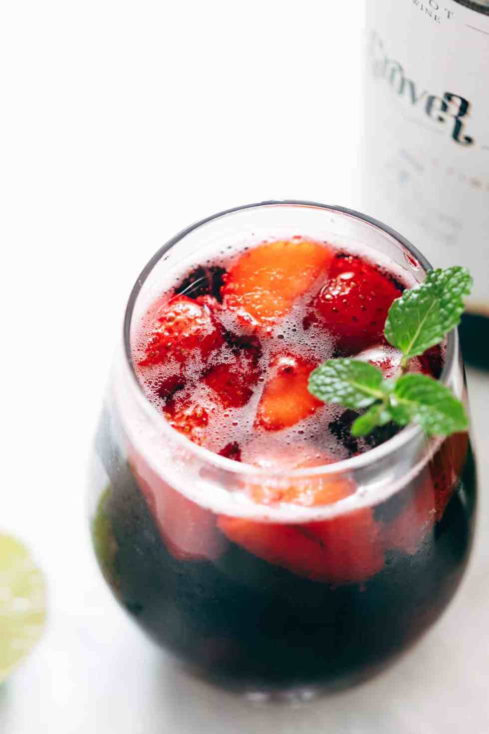 The Summer Berry Red Wine Spritzer is a cool, refreshing cocktail and a lot like the tinto de verano. Full of strawberries and blueberries, its perfect for times when you want to stay away from hard liquor and watch those calories while still enjoying a drink!