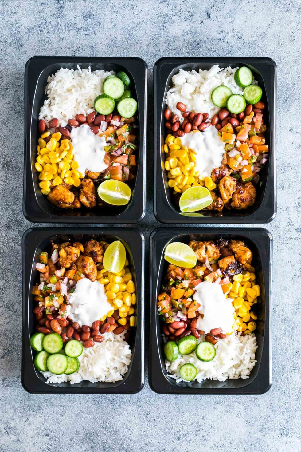 Easy chicken burrito meal prep bowls are perfect for planning weekday work lunches ahead! They are super tasty, gluten free and a healthy way to make sure you have home cooked lunch boxes ready to go.