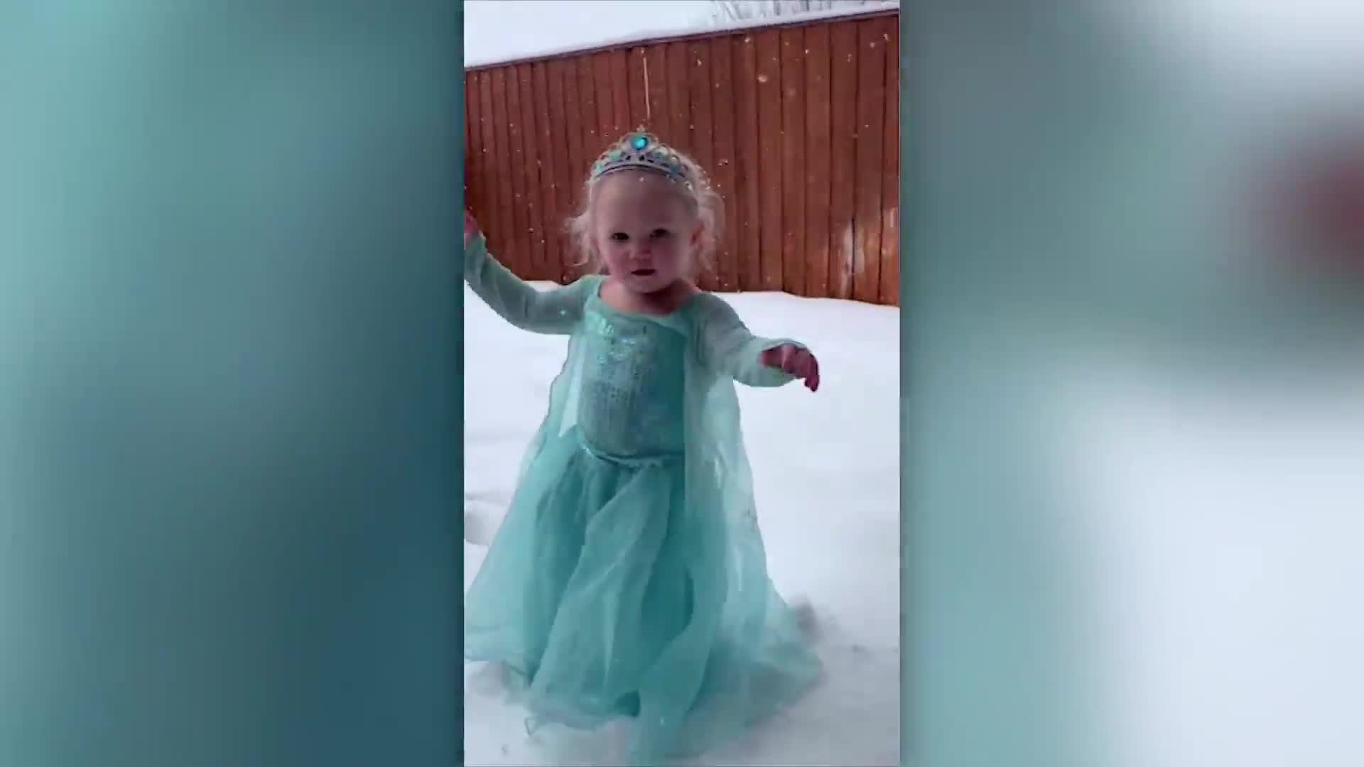 2-year-old girl belts out 'Let It Go' as she plays in snow for the first time