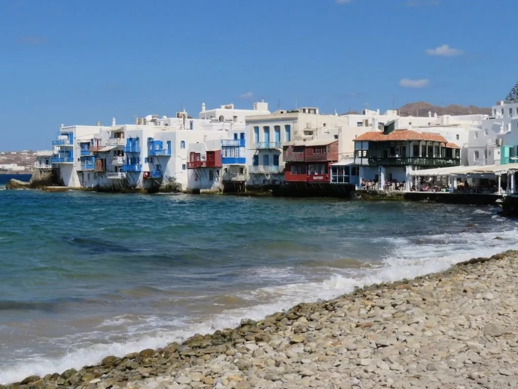 Mykonos in Greece.  View towards the bustling, tourist filled, seaside restaurants