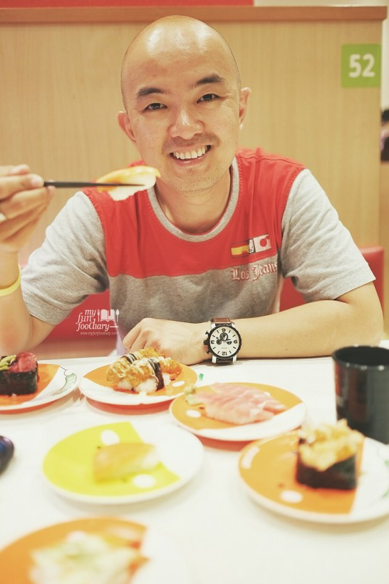 Him and his sushi at Premium Sushi Train KAIO Sushi by Myfunfoodiary
