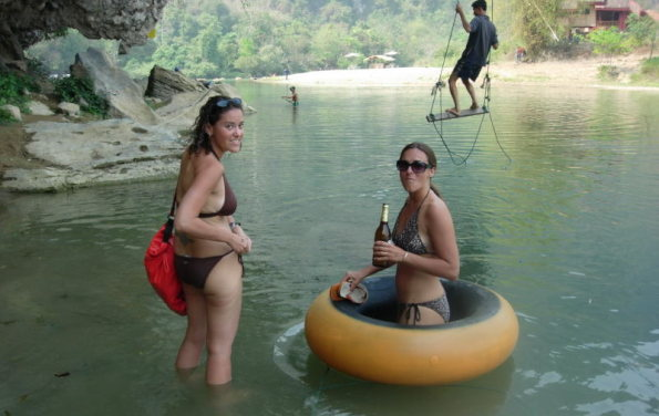 girls in bikini tubing in laos
