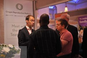 Craig Reisser from Oregon Reproductive Medicine talking to visitors about surrogacy in the USA