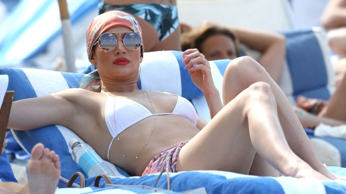 151576, Jennifer Lopez relaxes ahead of Mother's Day showing off her amazing figure in a white bikini on Miami Beach. The multi talented singer, actress and dancer sat back in a white bikini and her hair pulled off of her face in a silk scarf. Miami, Florida - Friday May 06, 2016. Photograph: Brett Kaffee/Thibault Monnier, © Pacific Coast News. Los Angeles Office: +1 310.822.0419 sales@pacificcoastnews.com FEE MUST BE AGREED PRIOR TO USAGE