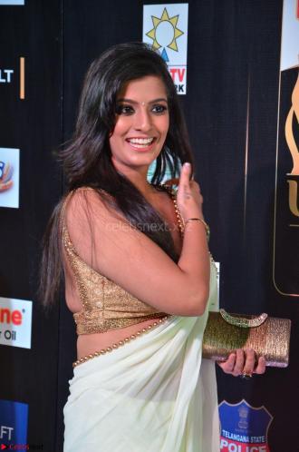 Varalakshmi in Cream Saree Sleeveless Backless Deep Neck Choli at IIFA Utsavam Awards March 2017 002