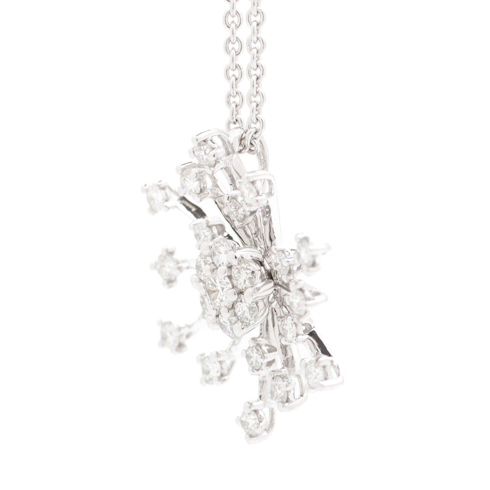 RADIATING ROUND DIAMOND HALO AND DIAMOND PAVE SNOWFLAKE