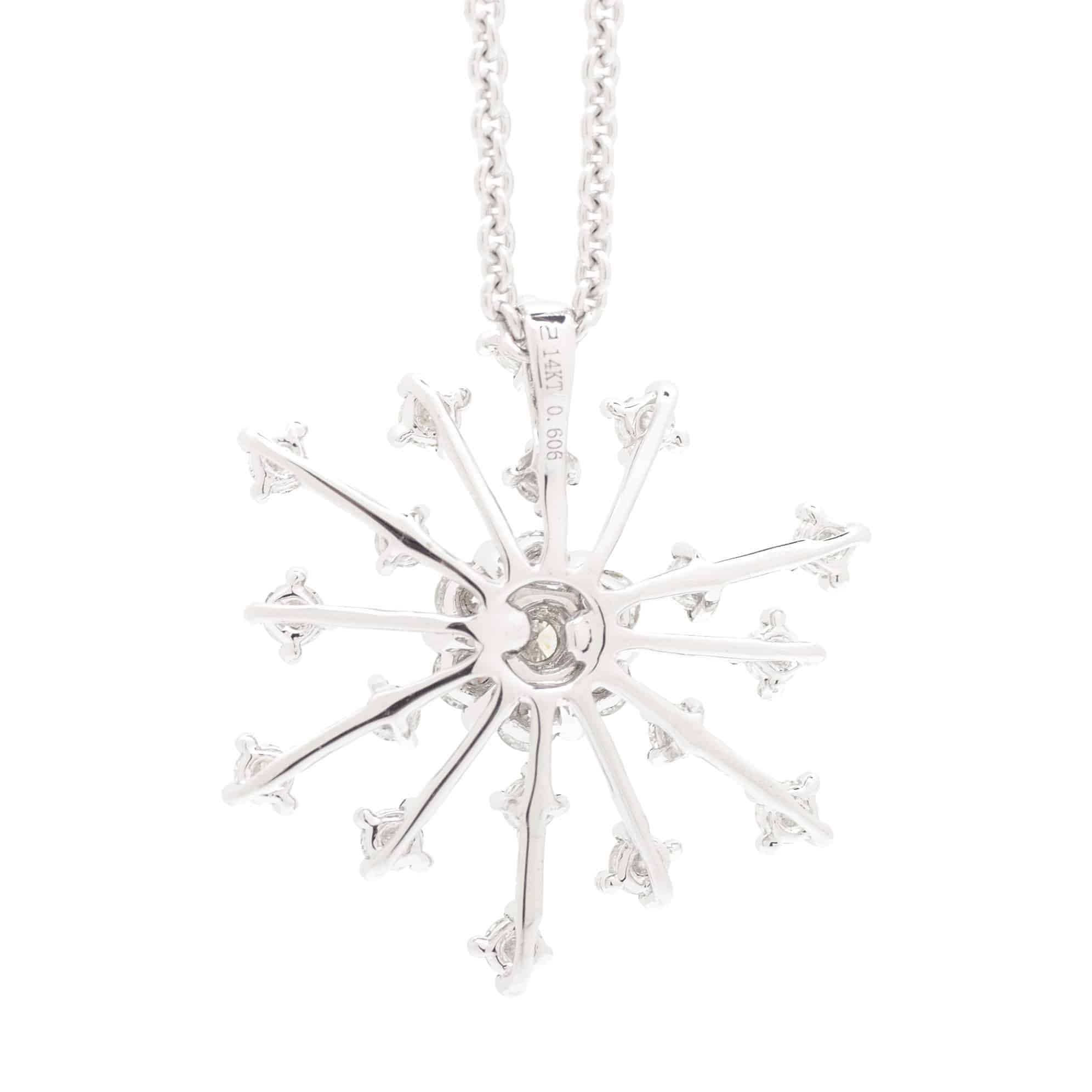 RADIATING ROUND DIAMOND HALO AND DIAMOND PAVE SNOWFLAKE