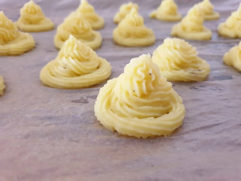 Piped duchess potatoes before baking