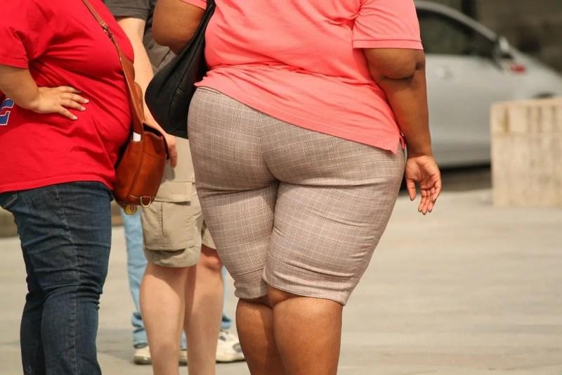 obese women walking the street