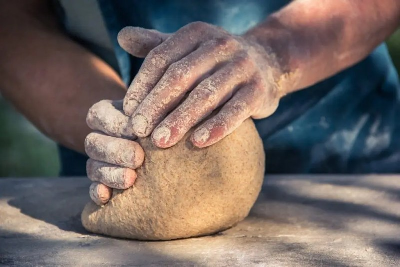 Kneading bread dough by hand.