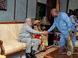 Mahama exchanges pleasantries with the Rawlings'