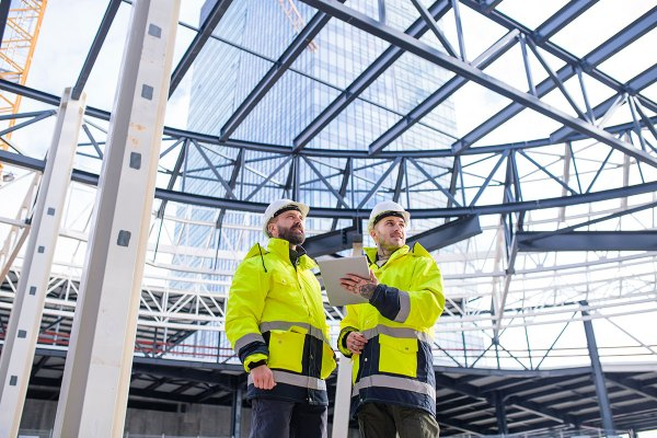 men-engineers-standing-outdoors-on-construction-si-small.jpg