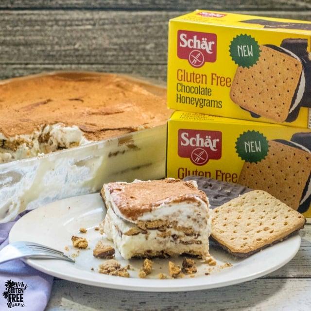 Gluten Free Tiramisu Ice Box Cake with boxes of Schar gluten free chocolate honey grahams