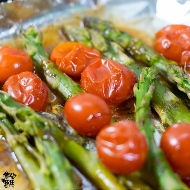 Close up of roasted asparagus and tomatoes