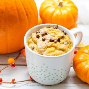 Gluten Free Pumpkin Spice Mug Cake with pumpkins and chocolate chips