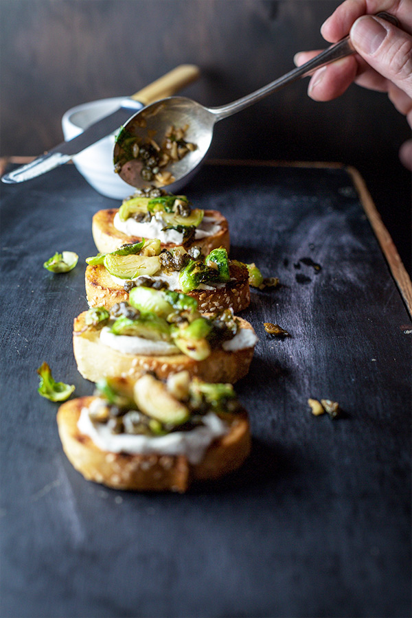 This amazing crispy sprout and caper bruschetta is amazing. It might even convert the most devoted of sprout haters to begrudgingly respect the ugly little cabbage.