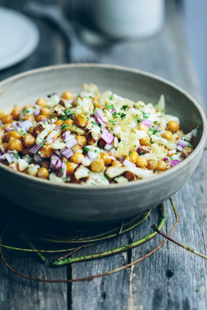 This roast chickpea cauliflower bowl with preserved lemon and mint is a super simple vegan salad packed with exotic flavours.
