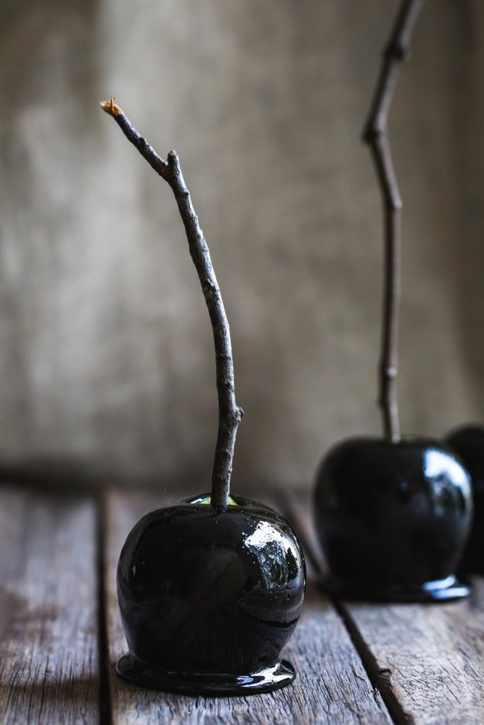 Made with charcoal, these Deliciously Dark Poison Apples are simple to make and ready to cast a sweet spell on All Hallow's Eve.