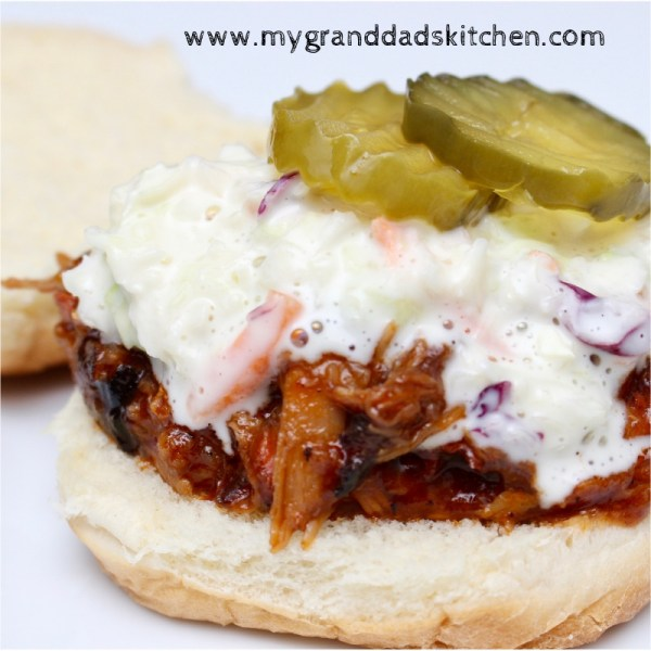This Super Easy to make crock pot pulled pork sliders will have you enjoying the game instead of slaving in the kitchen.